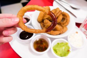 A BBQ Sauce Dipped Onion Ring at Ed's Easy Diner